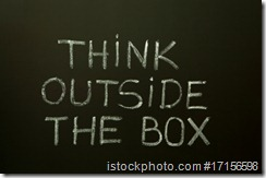 THINK OUTSIDE THE BOX on a blackboard