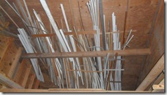 Trim storage in workshop rafters.