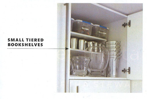 Having a small tiered bookshelf in a cabinet can help organize your items and provide you with more space to use.