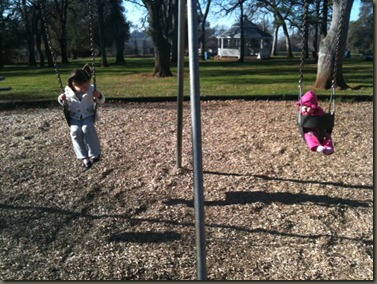 girls swinging