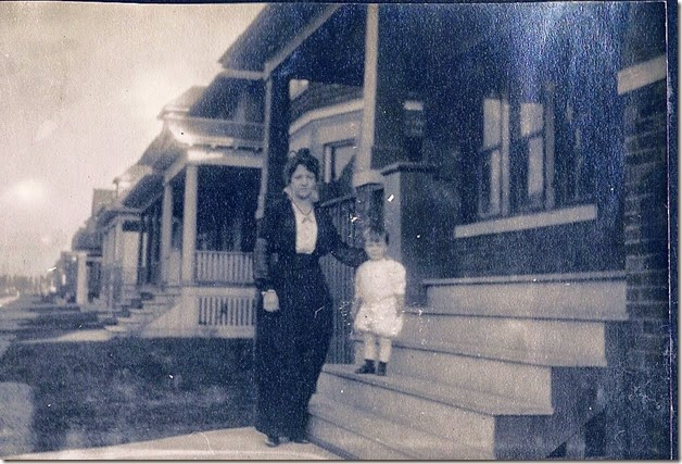 Dad with his mother on the steps_circa 1914