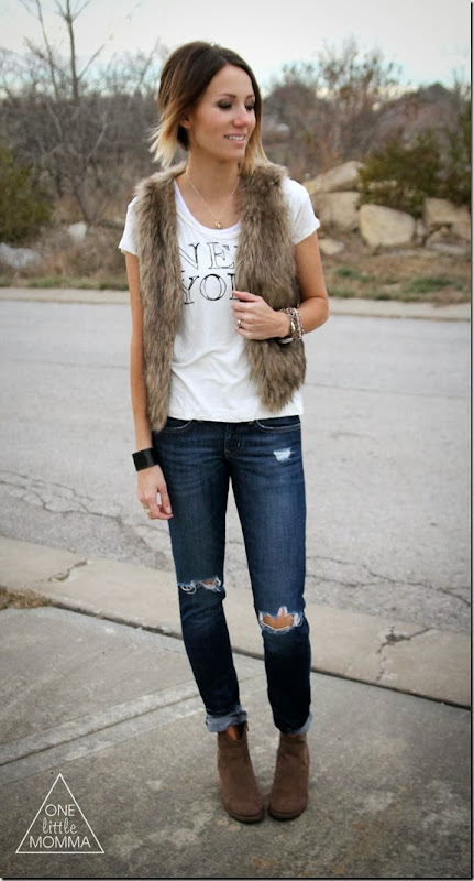 Fur vest, graphic tee and dark denim