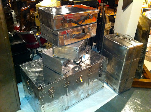 These metal trunks are so unusual. They would look great in a modern-looking room, with their sleek exteriors.