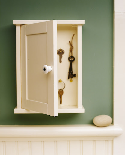 This key cubby is a great way to organize keys and hide them away . This type of miniature cabinet is an easy find at flea markets.