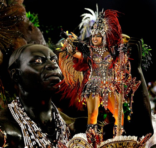 Performers from the Beija Flor samba school joi Carnival celebrations at the Sambadrome in Rio de Janeiro. (Silvia Izquierdo/Associated Press)