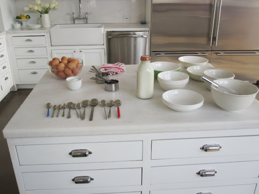 Setting up, with lots of spoons and bowls for Martha to choose from. In the end, she preferred a big, shallow dish for soaking the bread slices.