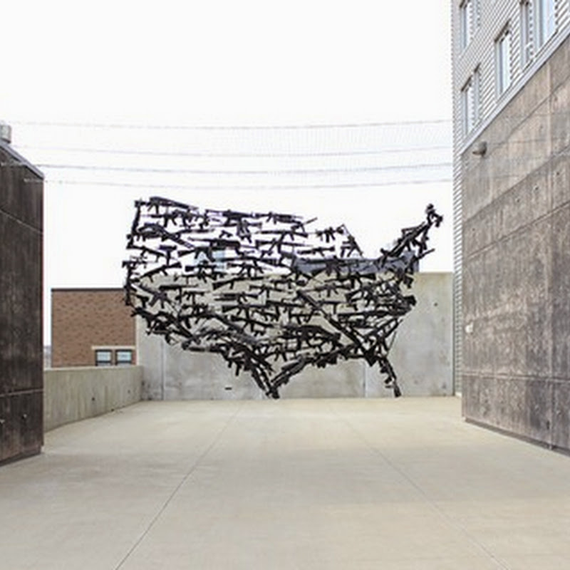 130 Suspended Toy Guns Form a Map of the USA.