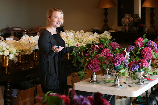 Amanda, from our team, finishes the beautiful arrangements in our on-site flower workshop.