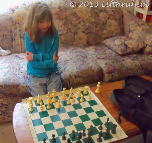 Setting up the chess board all by herself