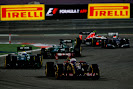 Romain Grosjean, Lotus E22 Renault, leads Marcus Ericsson, Caterham CT05 Renault, and Kamui Kobayashi, Caterham CT05 Renault