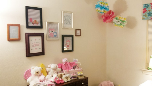 nursery gallery wall and poofs