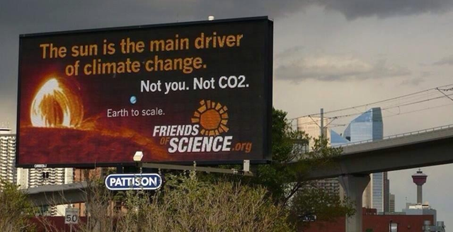 A billboard in Calgary, Canada reads 'The Sun is the main driver of climate change. Not you. Not CO2.' Fossil-fuel industry front group, 'Friends of Science', acknowledges it is real. Photo: Slate