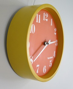 Verichron wall clock with an orange face and yellow case