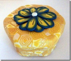 yellow box with blue flower side view