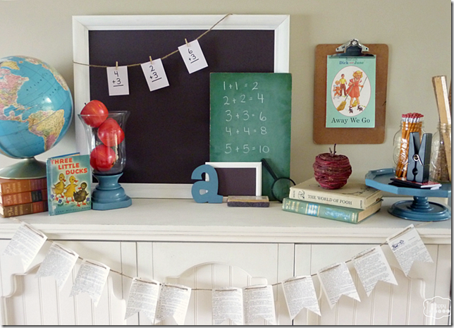 back-to-school-mantel-with-globe-chalkboards-vintage-books-apples-pencils-rulers-DIY-dictionary-page-buntings-at-thehappyhousie-1024x738