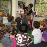 ... Nicole reads a story to the Kindergarten children ...