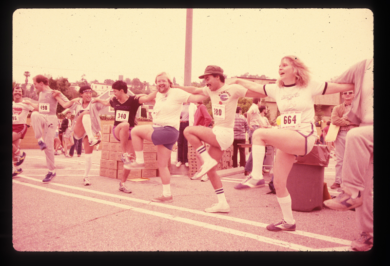 Preparing for the running race at the Los Angeles Christopher Street West pride parade. 1982.