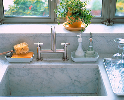De-clutter the sink area by storing soaps and scrubbers in pretty dishes.