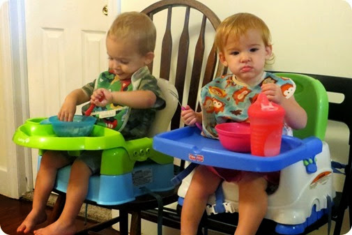 Twins Eating with Utensils
