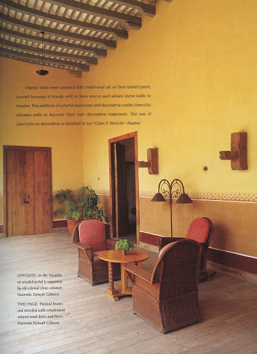 I love the rustic wood doors and floors coupled with delicately stenciled walls and painted wooden beams at Hacienda Itzincab Camara.