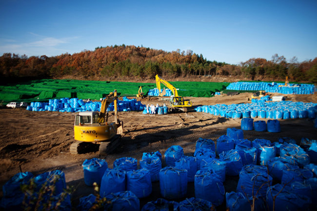 Cleanup in Kawauchi, a village in Fukushima Prefecture. In Okuma, decontamination efforts have been slow to reduce radiation dosages, and hopes of returning to their ancestral lands have faded for evacuated residents. Ko Sasaki for The New York Times