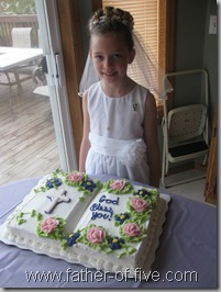 #5 of 5 with her First Communion bible shaped cake