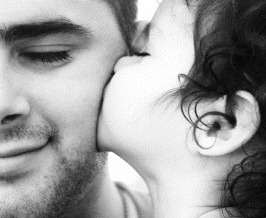 little girl kissing daddy