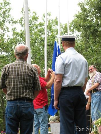 Far Guy hoisting the flag