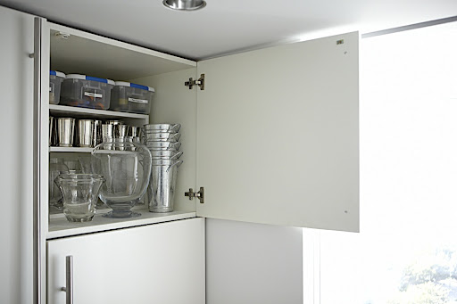 This idea did run in the article but I thought I would give you a more detailed view.  The cabinet above my refrigerator is the perfect place for my flower arranging supplies.