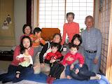 Starting in the back, going clockwise: Maria's aunt Hiroko, her husband Masuda-san, Hiroko's daughter Makiko holding Eidan, Maria holding Kai, Hiroko's daughter Akiko holding her daughter Karin, Maria's aunt-in-law Masako holding Makiko's son Tatsuki