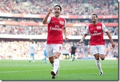 Arsenal's Mikel Arteta celebrates his goal against Aston Villa during an English Premier League soccer match, at the Emirates Stadium in London, Saturday, March 24, 2012. Arsenal won the match 3-0. (AP Photo/Lefteris Pitarakis)