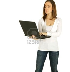 2549378-caucasian-girl-act-as-a-computer-geek-holding-up-black-laptop