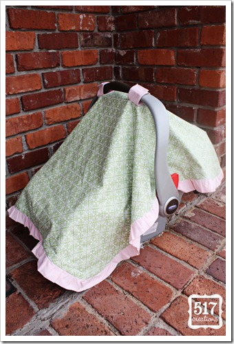 side of pink and green ruffled car seat canopy