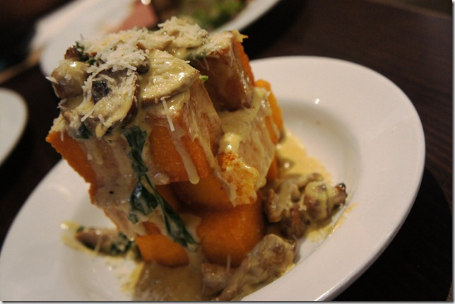 Polenta topped with gorgonzola and button mushrooms