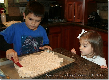 Spread Rice Krispie Treats in a thin layer.