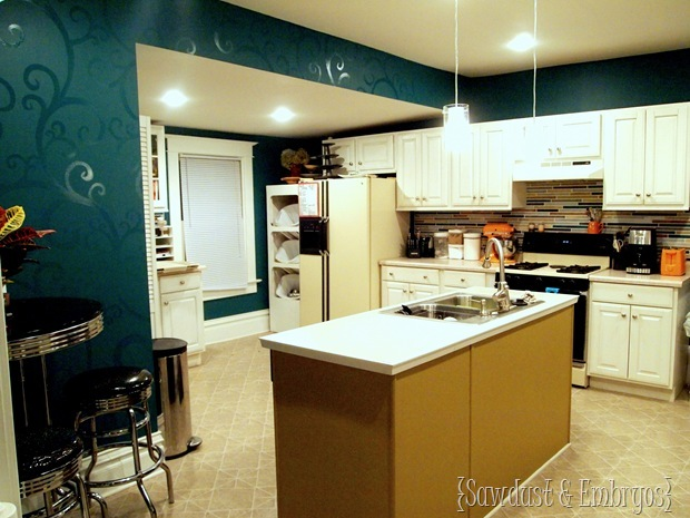 Kitchen with Glossy Swirls and Painted Backsplash