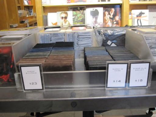 A variety of Marc Jacobs suede wallets can be found in the front of the store.