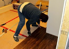 1411048 Nov 04 Barb Laying More Bedroom Floor