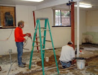 Henry Myers and Randy Gingerich cut out parts of the cement floor.  Photo Courtesy:  Iowa Mennonite School