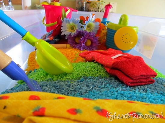 gardening and rainbow themed sensory bin for preschoolers - Rainbow Rice & Garden Sensory Play