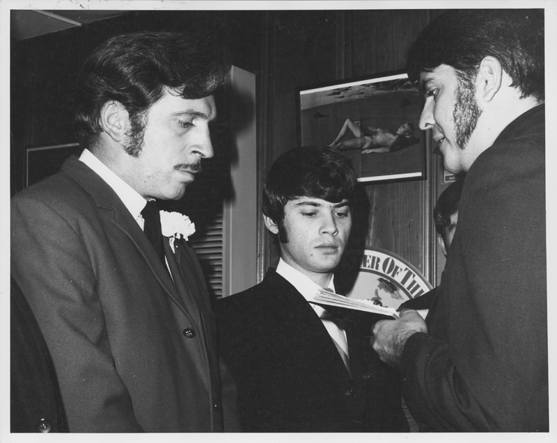 Reverend Troy Perry marries Jack Wilson (left) and Ron Douglas, members of the Metropolitan Community Church (MCC) and the Society of Pat Rocco Enlightened Enthusiasts (SPREE), in a private ceremony. 1970.
