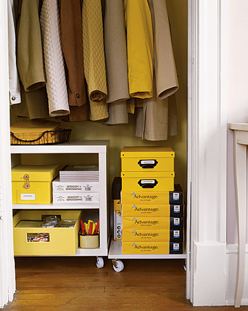 Make sure you utilize all of that space that's open below your coats. Make the most of it by setting up an office-supply storage system.