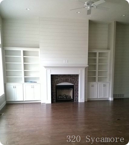 brick fireplace and built ins