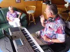 Karen Steen enjoying a moment with husband, Roy, who is playing his Korg Pa80.