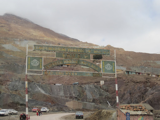 Cerro Rico and a sign for the miner's Co-Op