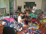 the kids are getting school supplies ready to deliver to kids in the disaster area
