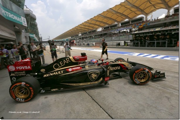 Sepang International Circuit, Sepang, Kuala Lumpur, Malaysia. Friday 28 March 2014. Romain Grosjean, Lotus E22 Renault, leaves the cockpit. Photo: Alastair Staley/Lotus F1 Team. ref: Digital Image _79P9663
