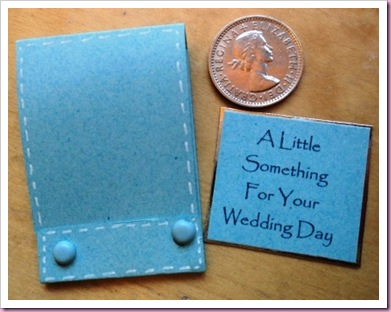 Brides matchbook with Lucky sixpence.