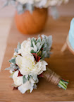 Sharla Flock created this bouquet using lambs' ear leaves to add softness. The raffia wrapped stems bring in touches of nude.