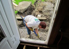 1405319 May 28 Barb Shoveling Gravel Under Joist